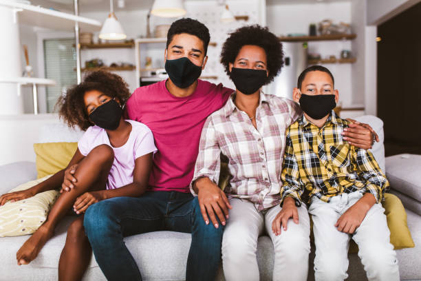 African American family wearing protective masks stock photo