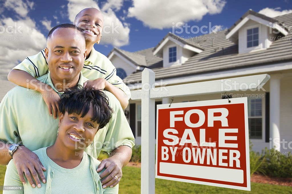 African American Family with For Sale By Owner Sign royalty-free stock photo