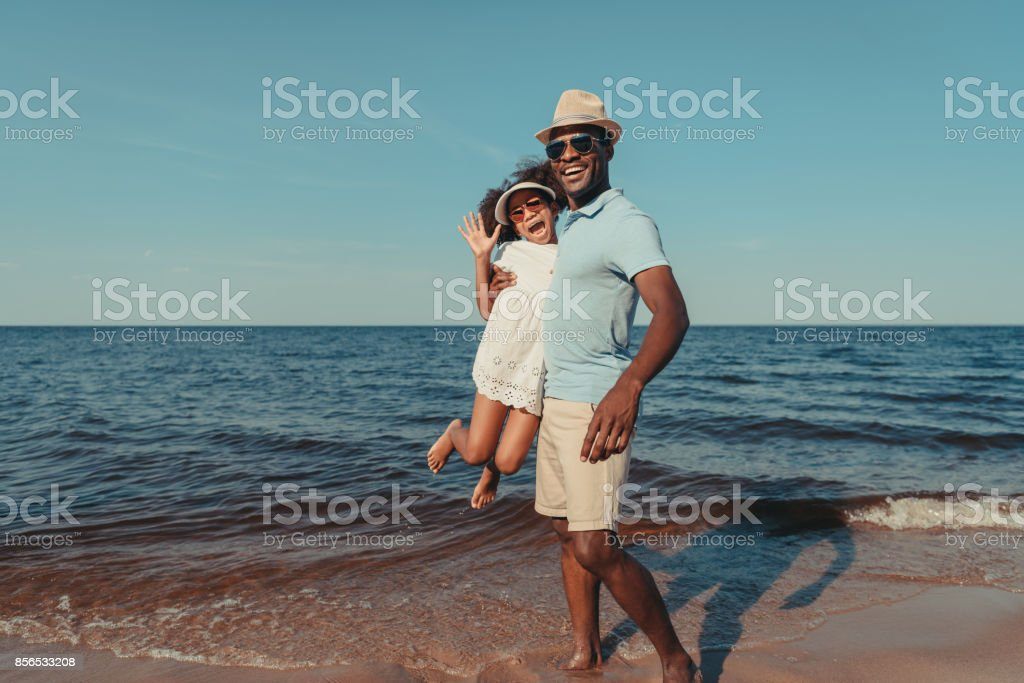 african american father and daughter stock photo