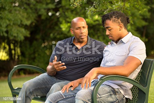 istock African American father and his son. 1077033366