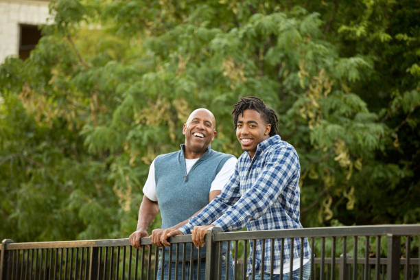 African American father and his son. stock photo