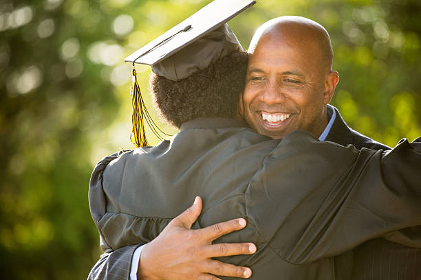 African American Father and son on Graduation Day stock photo