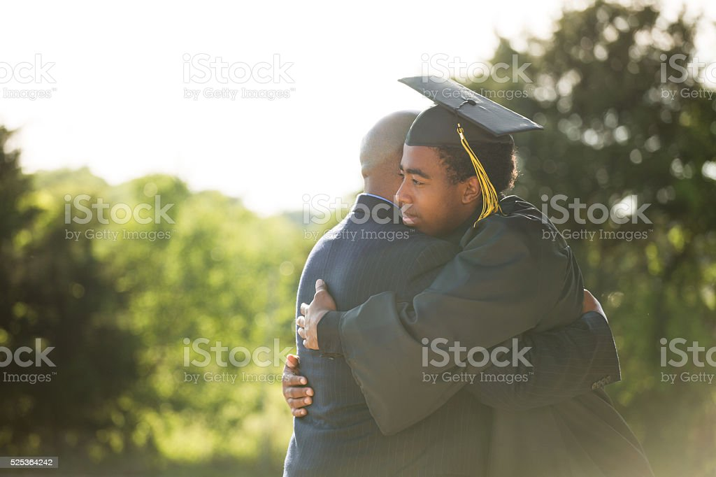 African American Father and son on Graduation Day bildbanksfoto
