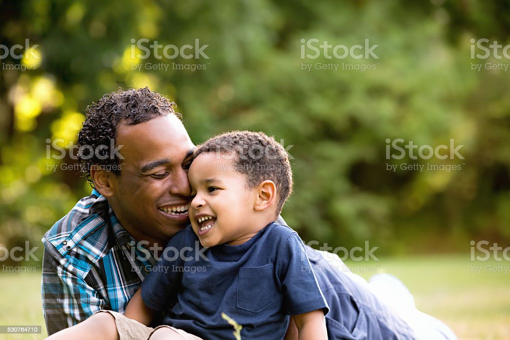 African American Father and Young Son outdoors royalty-free stock photo