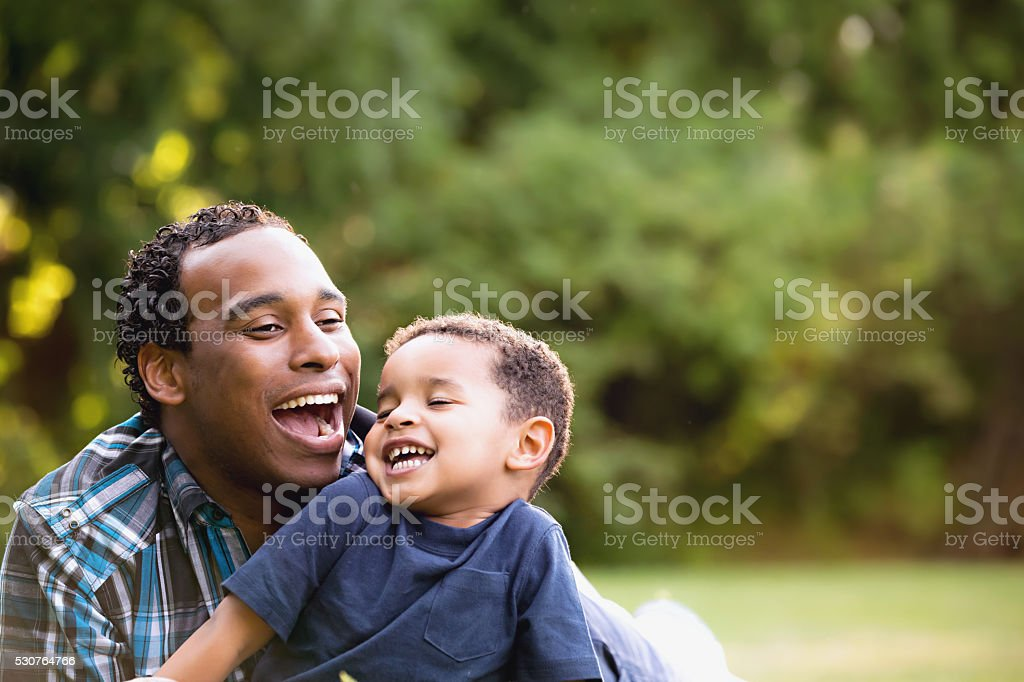 African American Father and Young Son outdoors stock photo
