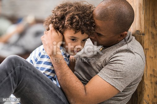 istock African American father consoling his small sad son at home. 947778230