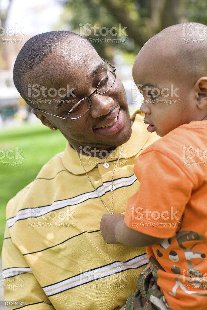 african american father holding his 2 year old son royalty-free stock photo