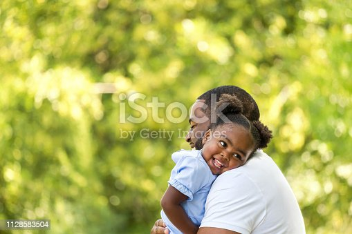 African American father and daughter.