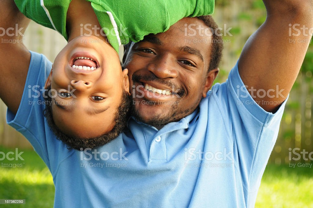 African American Father Playing Happily with His Son stock photo