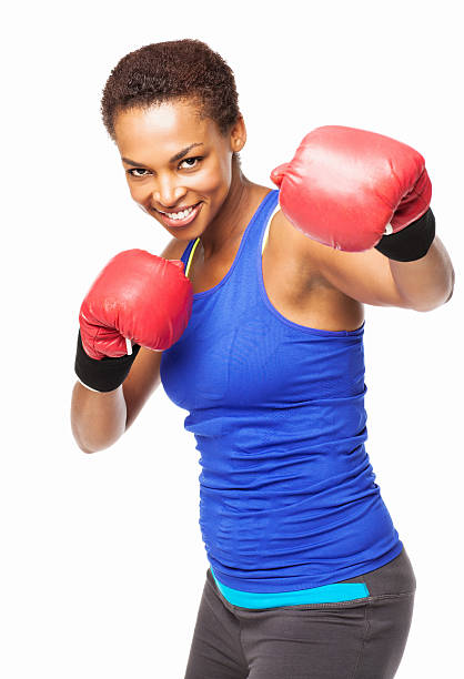 African American Female Boxing In Red Gloves - Isolated stock photo