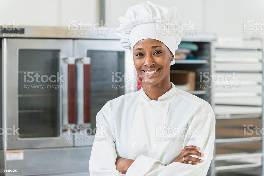 African American female chef in commercial kitchen - Photo