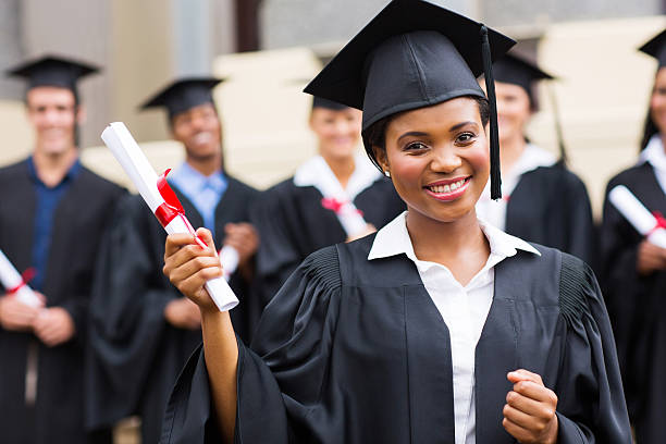 african american female graduate at ceremony stock photo