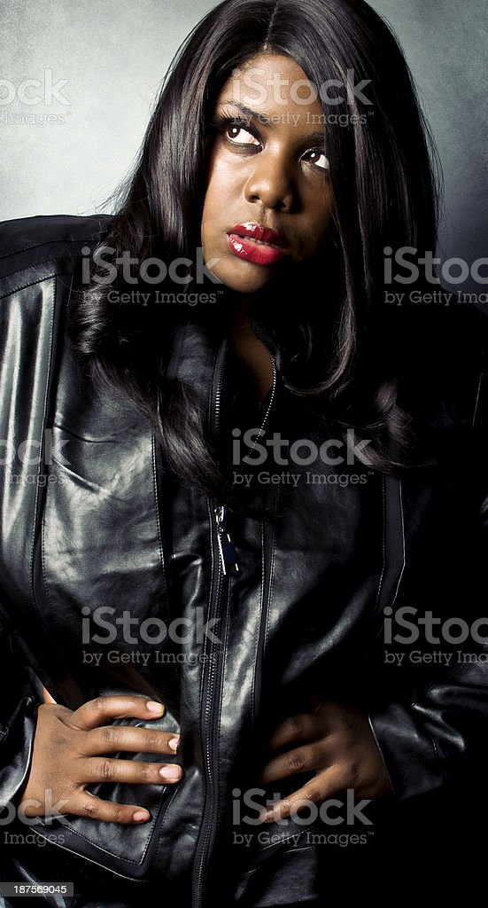 African American Female High Fashion Pose In Black Leather royalty-free stock photo