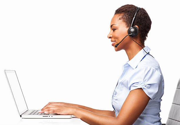 African American Female IT Operator Typing On Her Laptop-Isolated stock photo