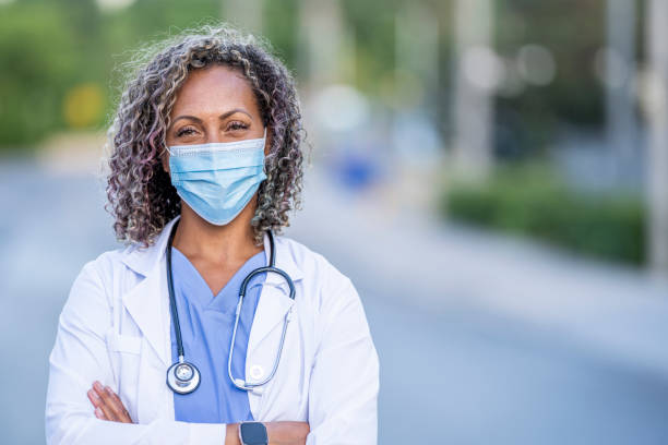 African American female medical professional wearing a protective face mask stock photo