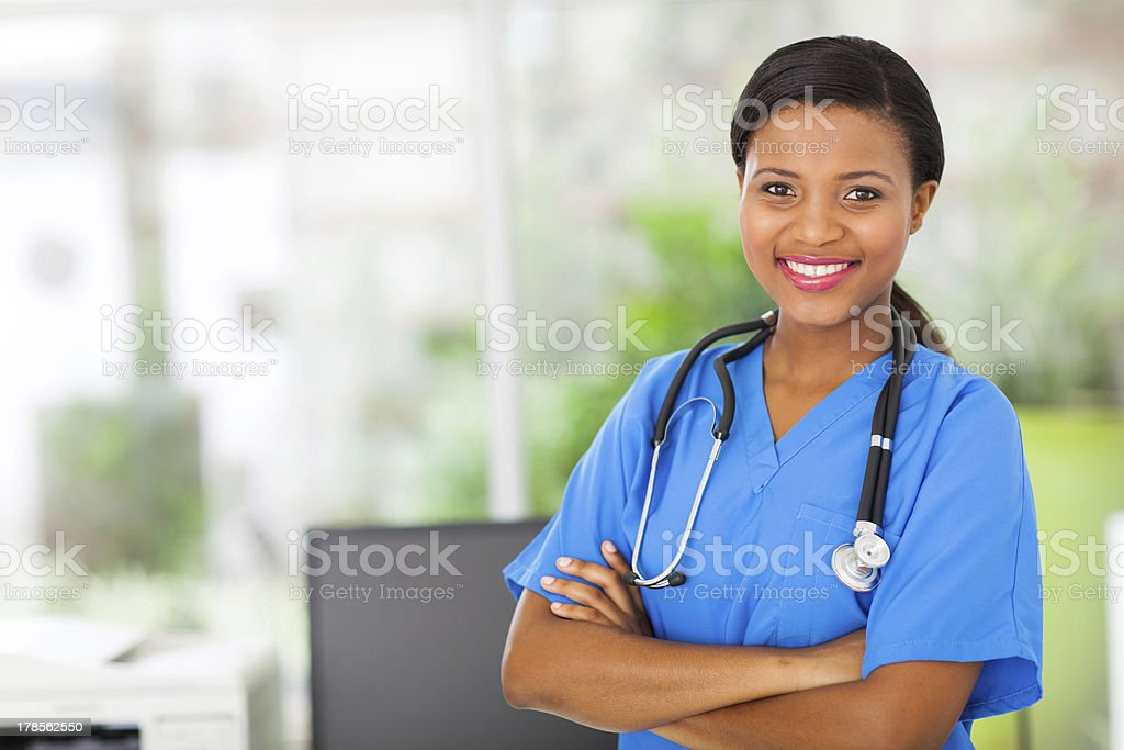 african american female pediatric nurse in office stock photo