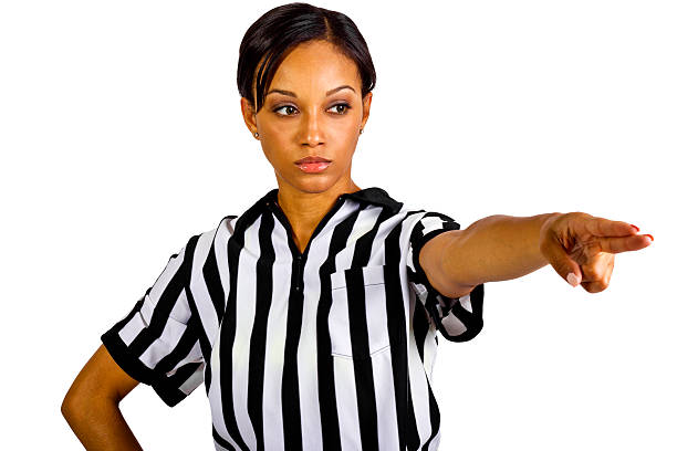 african american female referee wearing a striped uniform - judge sports official stock photos and pictures