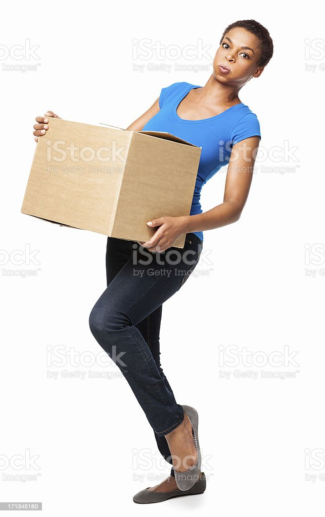 African American Female Stumbling While Carrying Cardboard Box stock photo
