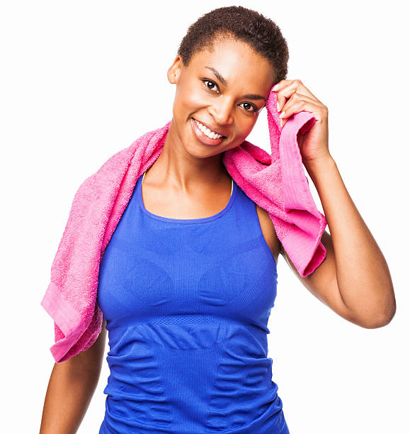 african american female wiping sweat after workout - isolated - black woman towel workout bildbanksfoton och bilder
