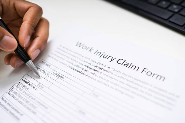 African American Filling Worker Compensation stock photo