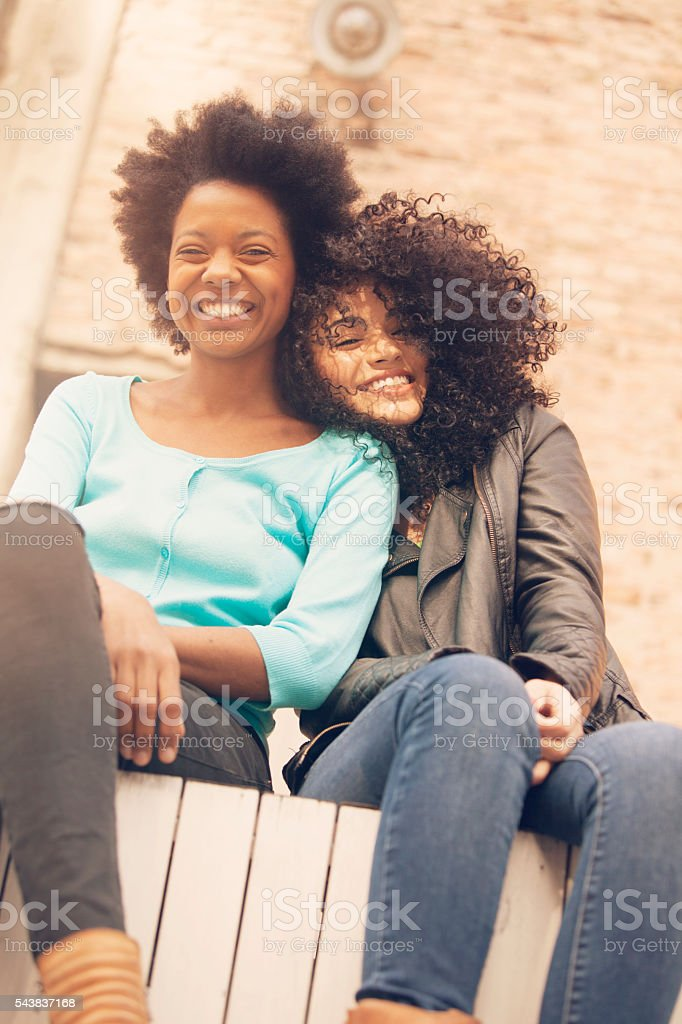 African american friends having fun outdoors stock photo