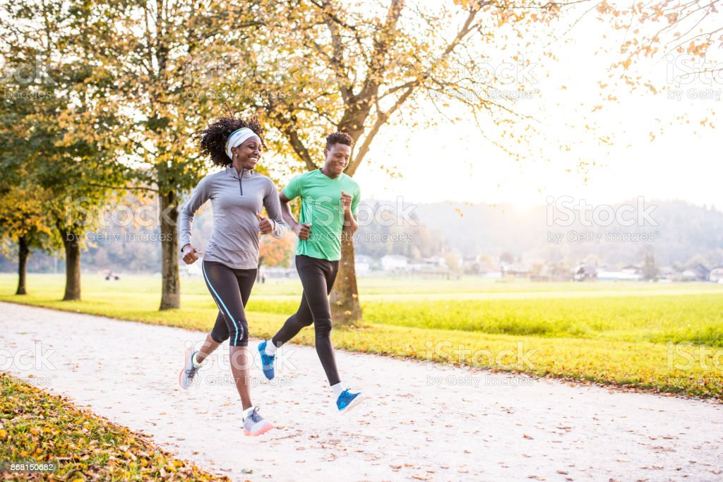 African American friends running together in nature stock photo