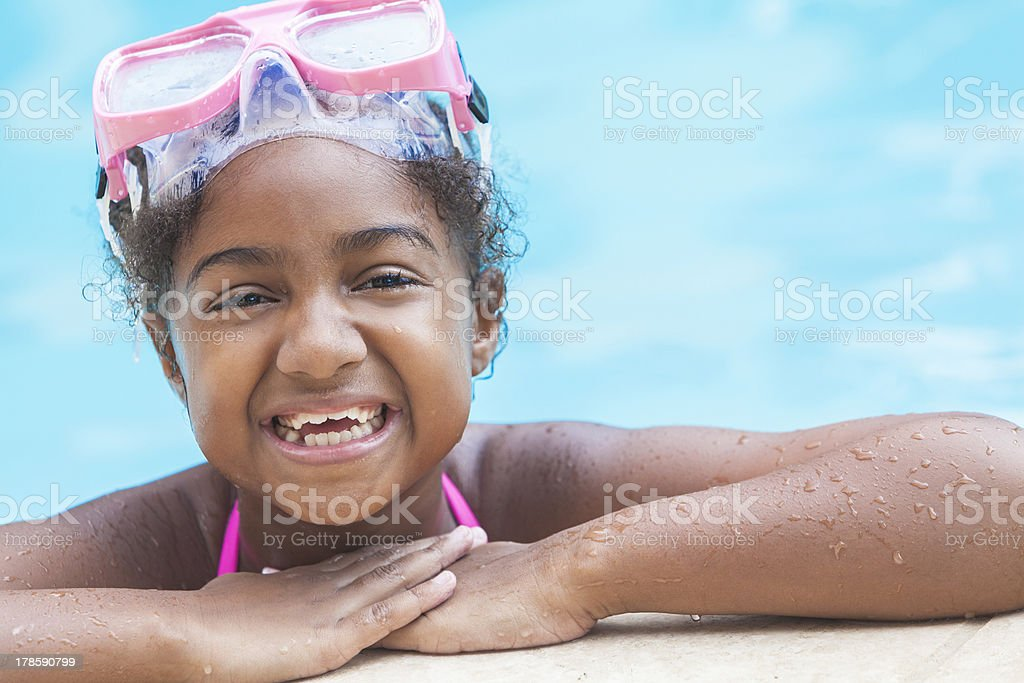 African American Girl Child In Swimming Pool with Goggles stock photo