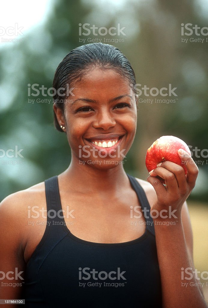 African American girl eating an apple royalty-free stock photo