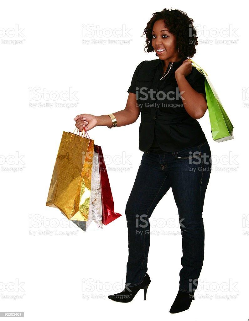 Afroamerikanische Mädchen Holding Einkaufstaschen Lizenzfreies stock-foto
