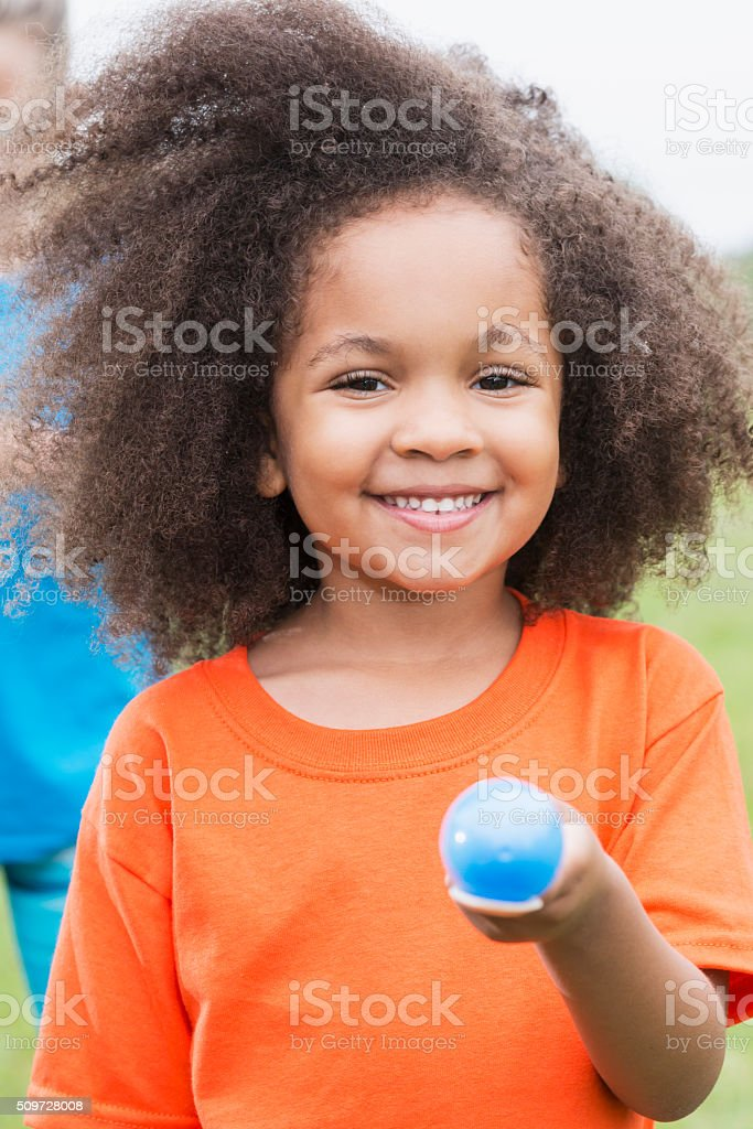 African American girl in an egg spoon race stock photo