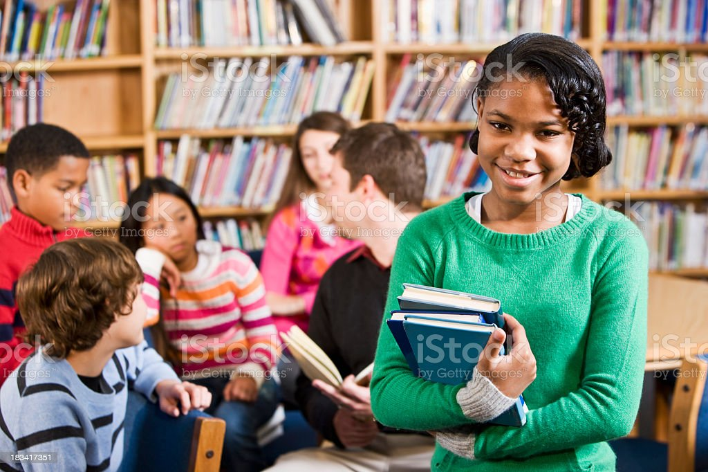 African American girl in school library smiling royalty-free stock photo