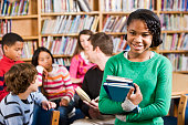istock African American girl in school library smiling 183417351