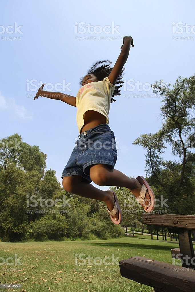 African American Girl Jumping royalty-free stock photo