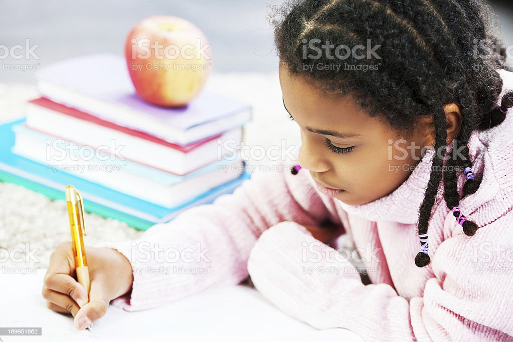 African American girl learning at the home royalty-free stock photo