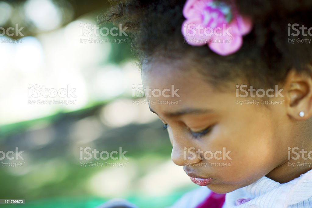 African American Girl Looking Down stock photo