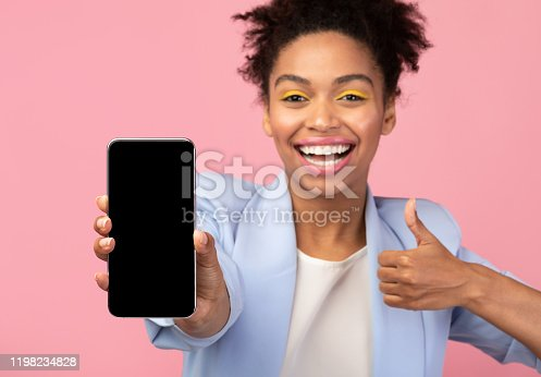 1084491176 istock photo African american girl showing blank cellphone screen 1198234828