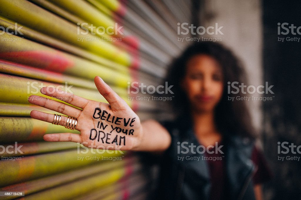 African American girl with inspirational meassage written on her hand stock photo
