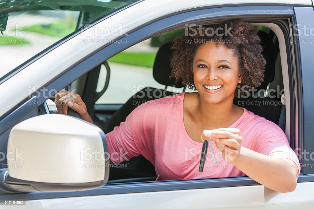 African American Girl Young Woman Driving Car Holding Key stock photo