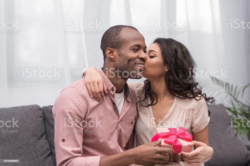 african american girlfriend kissing boyfriend on 8 march stock photo