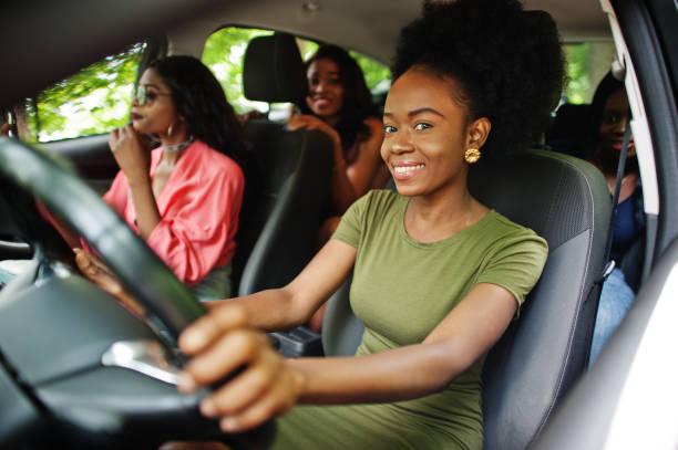 African american girls friends having fun in the car. stock photo