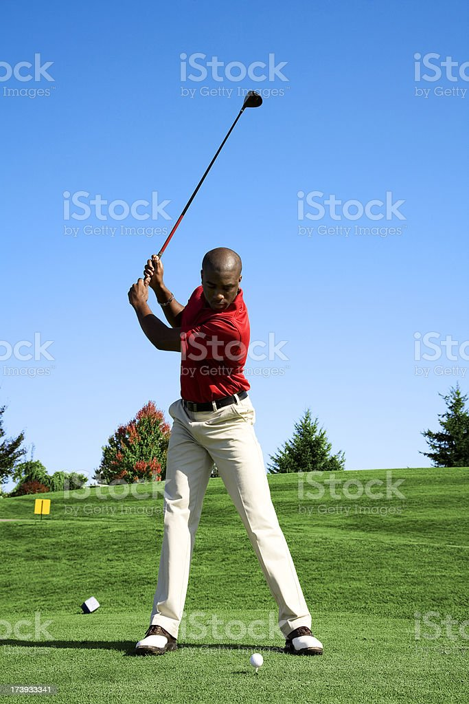 African American Golf swing green grass club course shoes royalty-free stock photo