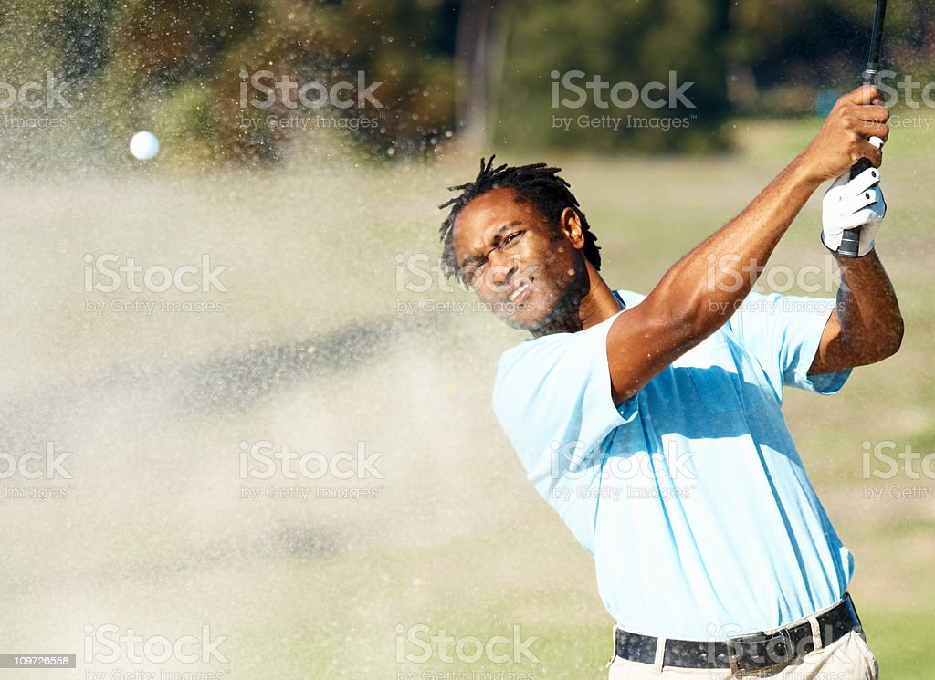 African American golfer during a game of golf stock photo