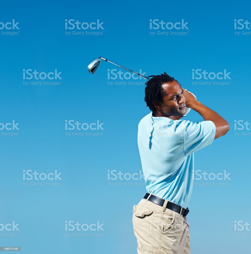 African American golfer hitting an iron royalty-free stock photo