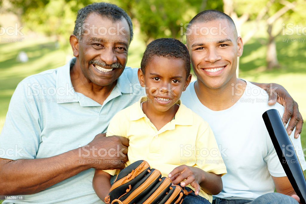 African American Grandfather, Father And Son Playing Baseball stock photo