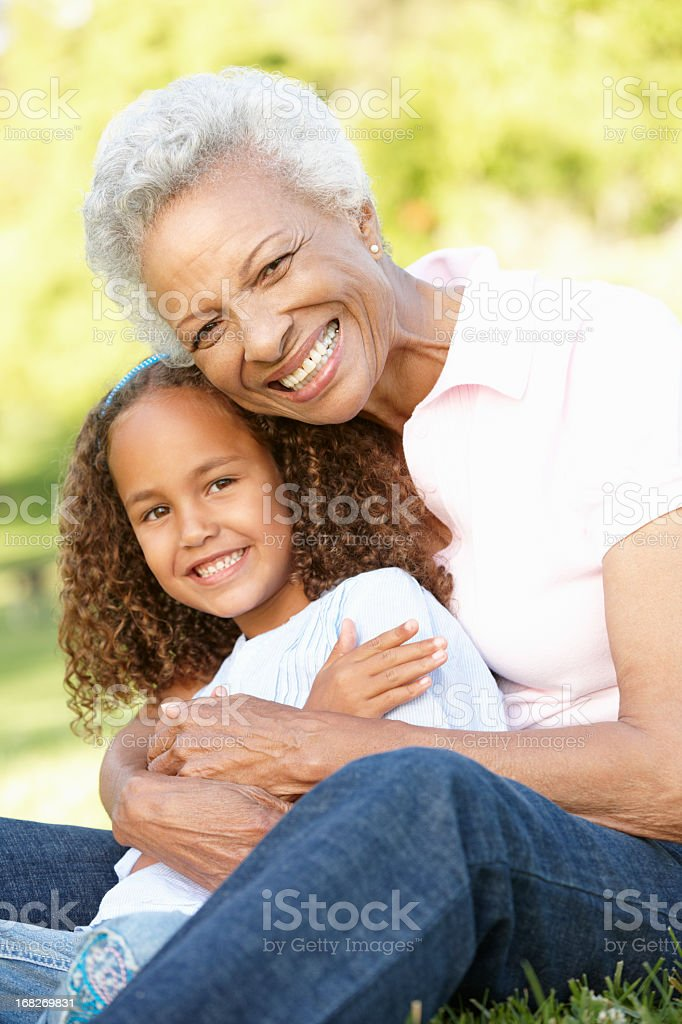 African American Grandmother And Granddaughter In Park stock photo