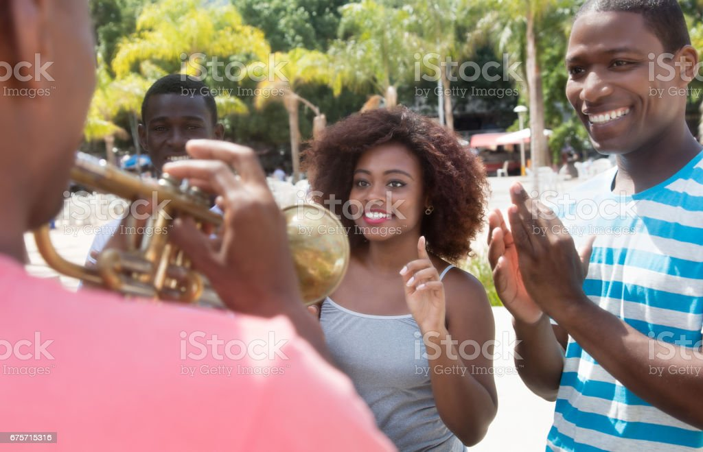 African american group enjoy music of musician with trumpet 免版稅 stock photo
