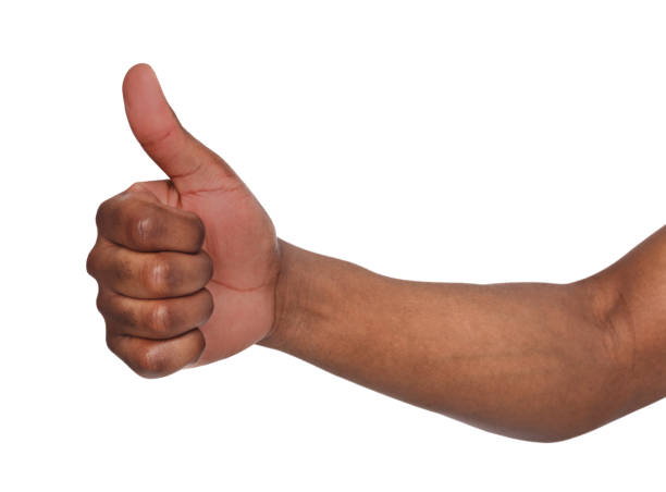 african american hand making thumb up gesture - thumb stock photos and pictures