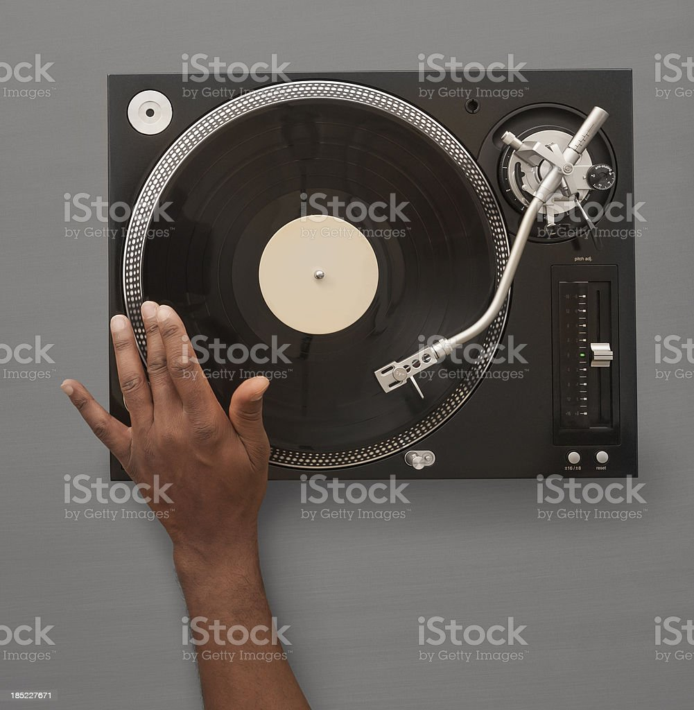African American Hand spinning record on turn table stock photo