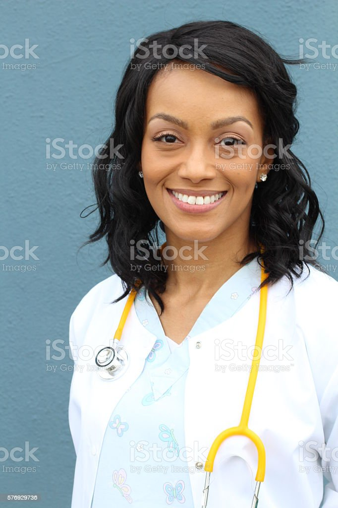 African American healthcare professional with lab coat and stethoscope stock photo