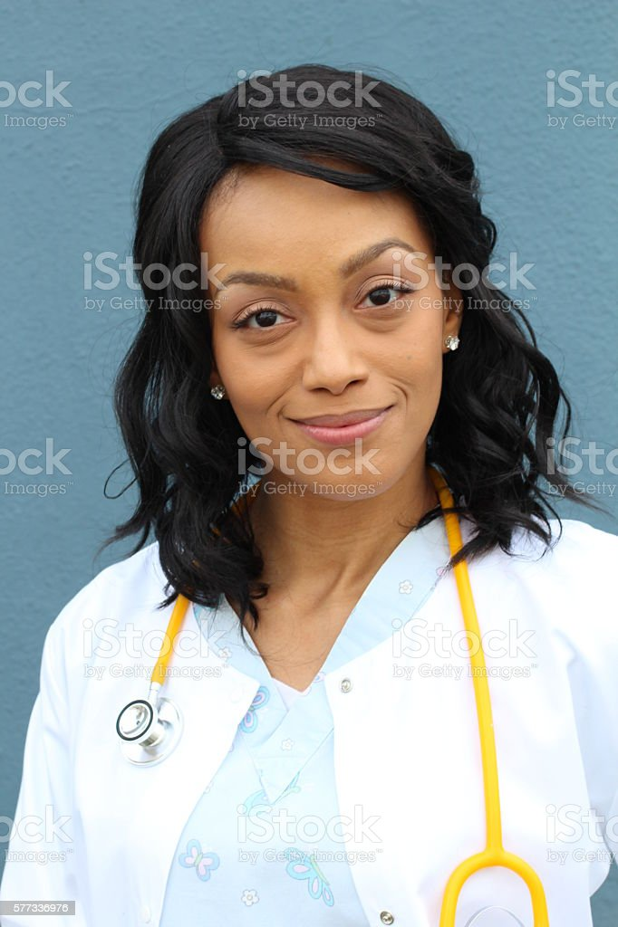 African American healthcare professional with lab coat stock photo